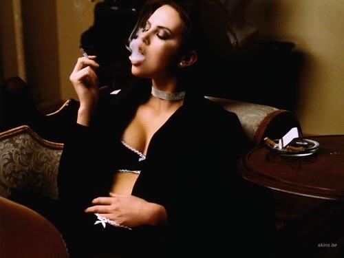 Charlize Theron smoking cigar