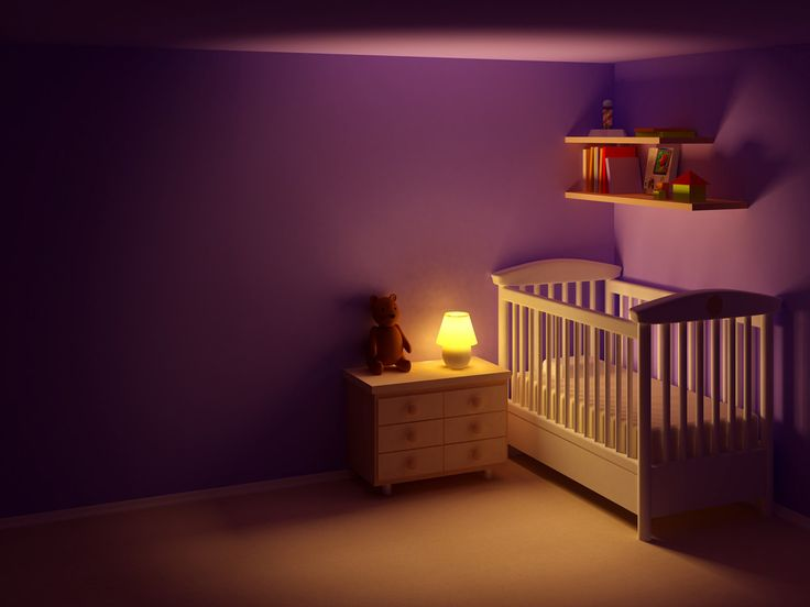 soft lamp light next to baby's cot