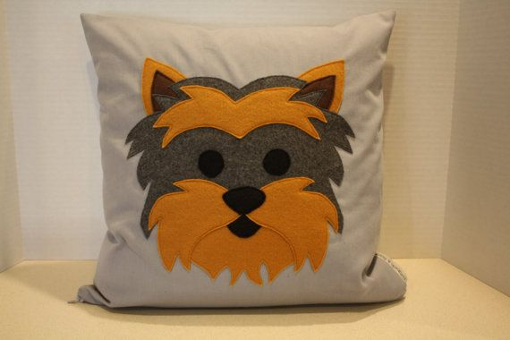 Yorkie felt appliqué dog pillow dimensions: 16x16 The pillow has a poly-fil insert with a nylon zipper closure. The felt is 100% Eco-fi polyester. The pillow is made from a cotton canvas material. It can be spot cleaned, or dry clean only.