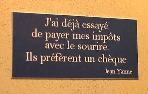 "Jai deja essaye de payer mes impots avec le sourire. Ils preferent un cheque :) Haha ""I've already tried paying my taxes with smiles. They prefer a check."""