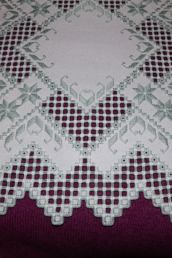 This gorgeous, extremely detailed and elegant doily was stitched on 25 count Lugana antique white fabric and was stitched with Moss Green DMC thread. This centerpiece measures approximately 16 by 16 inches. There is a large amount of cut out detail on the entire piece so the color placed behind the doily can be seen. The quality of the stitches is not easy to find - very neat and even. This form of detailed needlework involves counted thread stitches, drawn thread work and many pulled…