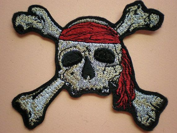 This is nice simple pirate and crossbones applique in a small size measuring 3 1/2 inches by 3 inches. It is the perfect size to put on the