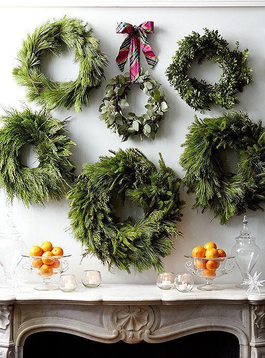 Turn the wall above your fireplace into a gallery of greenery. Hang wreaths in a row, or form them into a loose grouping—whatever arrangement suits your space and your fancy.
