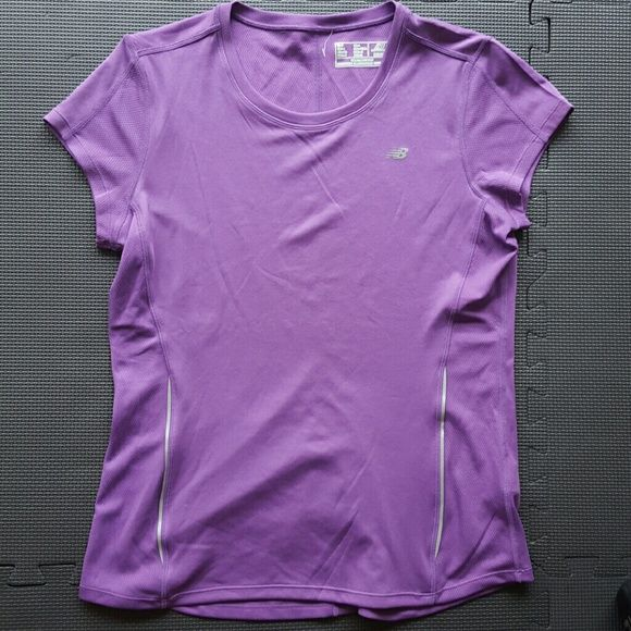 New Balance Purple Short Sleeve Top Poly.  Reflective piping on both sides.  Only worn once. New Balance Tops Tees - Short Sleeve
