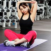 woman stretching at the gym