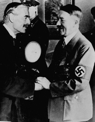 Not quite but very, very close. Great Britain--British Prime Minister Nevile Chamberlain and Hitler.