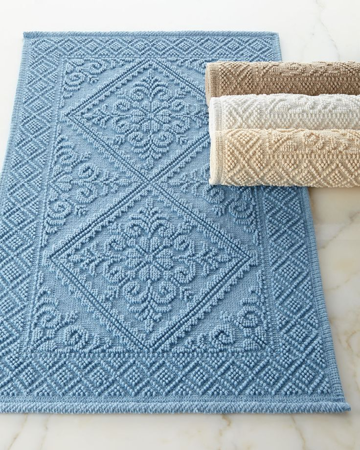 "Tiny loops not only create the raised trellis pattern but also give this bath rug nice texture. Made of cotton. 21"" x 34"". Machine wash. Imported."