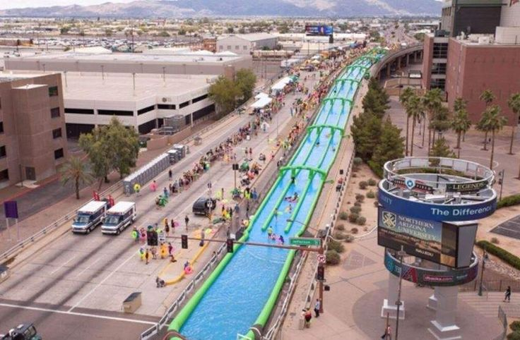 Slide the City's 1,000-foot ''slip and slide,'' seen here during an event in Arizona, is coming to Tampa in May. SLIDE THE CITY