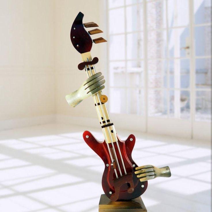 wooden sculptures music guitar
