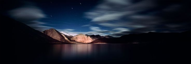Photographed at night during a full moon, Pangong Tso is a very long saline lake that extends from Ladakh in India to Tibet in China. It is located in the disputed territory between India and China in the Aksai Chin region. © Matjaz Krivic