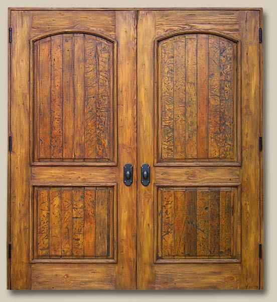 Rustic Doors Distressed panels of salvaged lumber are set into frames of reclaimed Douglas fir in these custom double closet doors. They are accented with cast bronze hardware. 7629L Newcomb