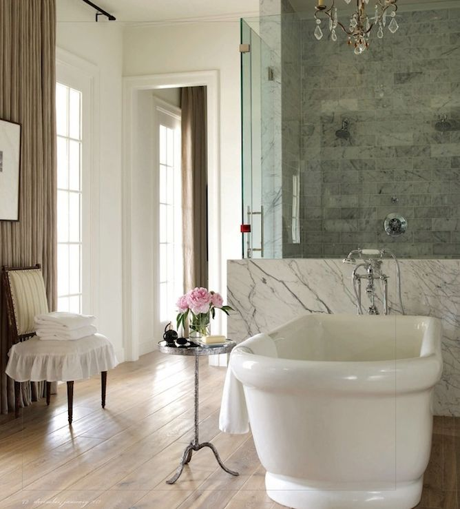 This one for the ruffled chair and flowers!    Suzie: Bella Casa Design - Elegant bathroom with freestanding tub, marble backsplash, seamless ...