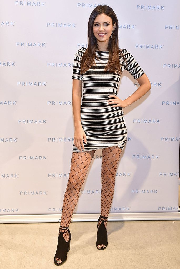 Victoria Justice Tights - Victoria Justice made clashing patterns work with this fishnet stockings and striped dress combo.