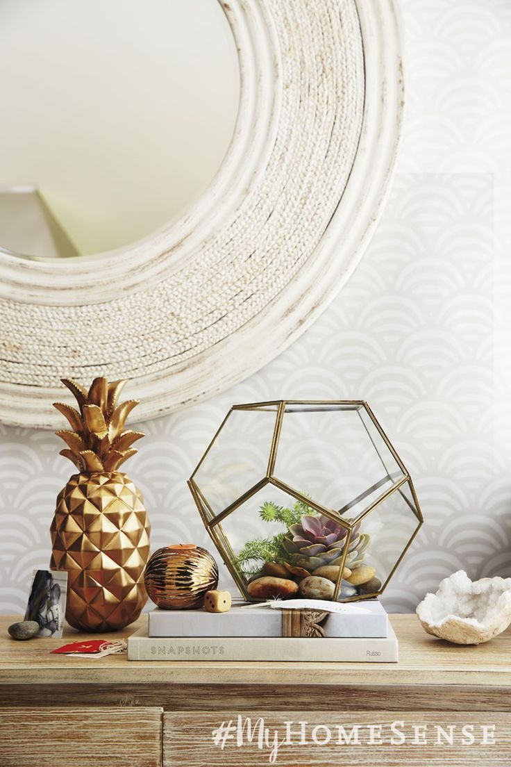 Create your own tabletop oasis with décor accents like a gold pineapple and a glass geo terrarium.