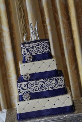 It even has an M on top!  Cobalt Blue Wedding Cake, http://thingsfestive.blogspot.com/2012/08/real-cobalt-blue-wedding-in-bowling.html