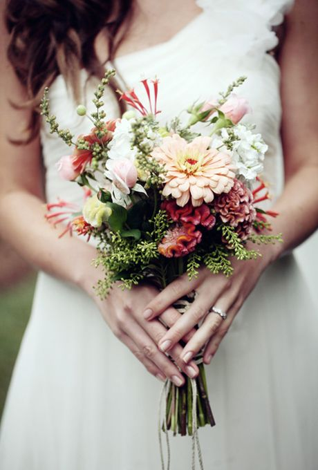 Brides.com: 15 Pretty Peach Bouquets. Peach, white, and pink wildflower bouquet with cockscombs, zinnias, hyacinth beans, old-fashioned garden roses, honeysuckles, and phlox from Flora Verdi.