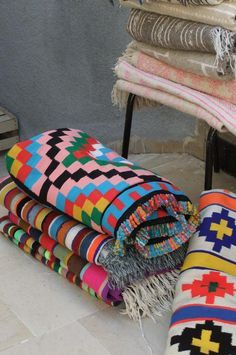 These rugs remind me of the handmade blankets we bought from Cozumel Mexico! :) sooo pretty