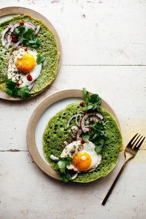 Green Lachuch with fried egg, herbs, and cheese