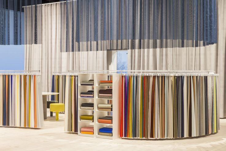 A draped, grey curtain by Doshi Levien beautifully envelopes our exhibition space at Orgatec. Photo: Patricia Parinejad