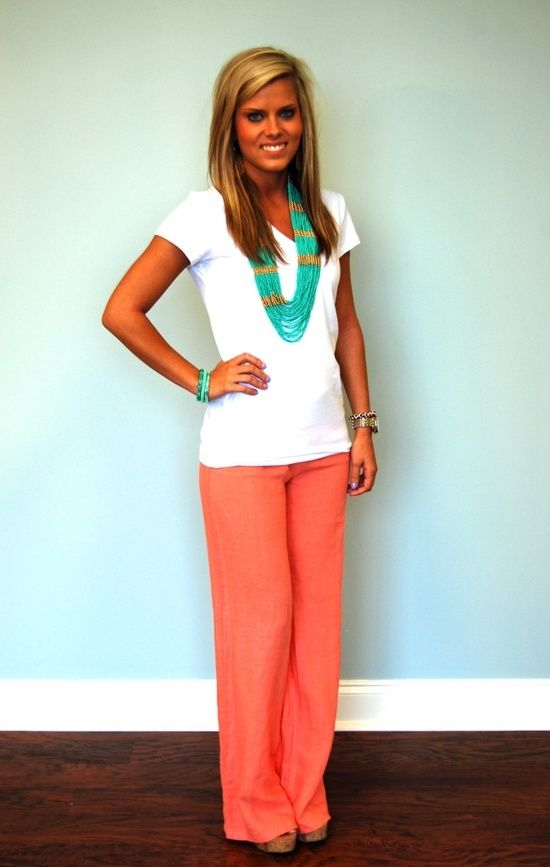 love the coral pants and the turquoise necklace that brings out the entire outfit!!