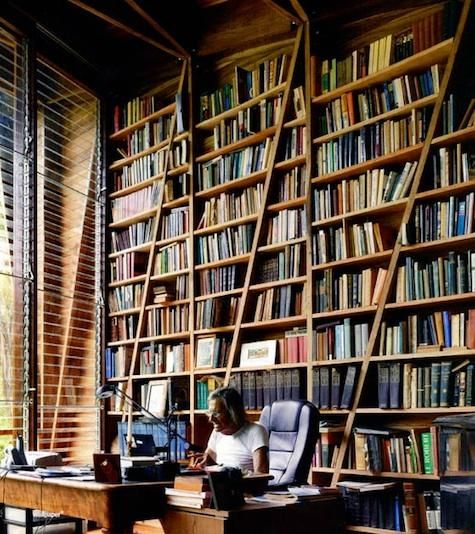 """London-based Gianni Botsford of Gianni Botsford Architects designed Casa Kike in Costa Rica for his father (and his vast collection of books) as a writer's retreat. The innovative structure is comprised of two pavilions (a main studio space with library, writing desk, and grand piano and a second sleeping pavilion) connected by a walkway"""