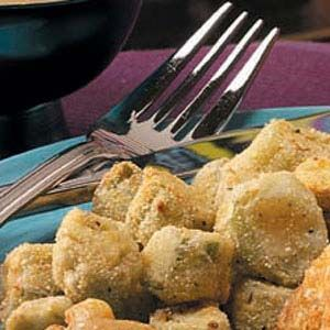 1-1/2 cups sliced fresh or frozen okra, thawed 3 tablespoons buttermilk 2 tablespoons all-purpose flour 2 tablespoons cornmeal 1/4 teaspoon salt 1/4 teaspoon garlic herb seasoning blend 1/8 teaspoon pepper Oil for deep-fat frying Additional salt and pepper, optional