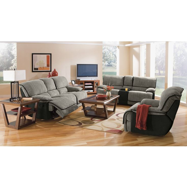 bobs living room sets%0A The welcoming touchability of the Laguna living room set is evident in its  steelcolored fabric and black leatherlike trim and sides