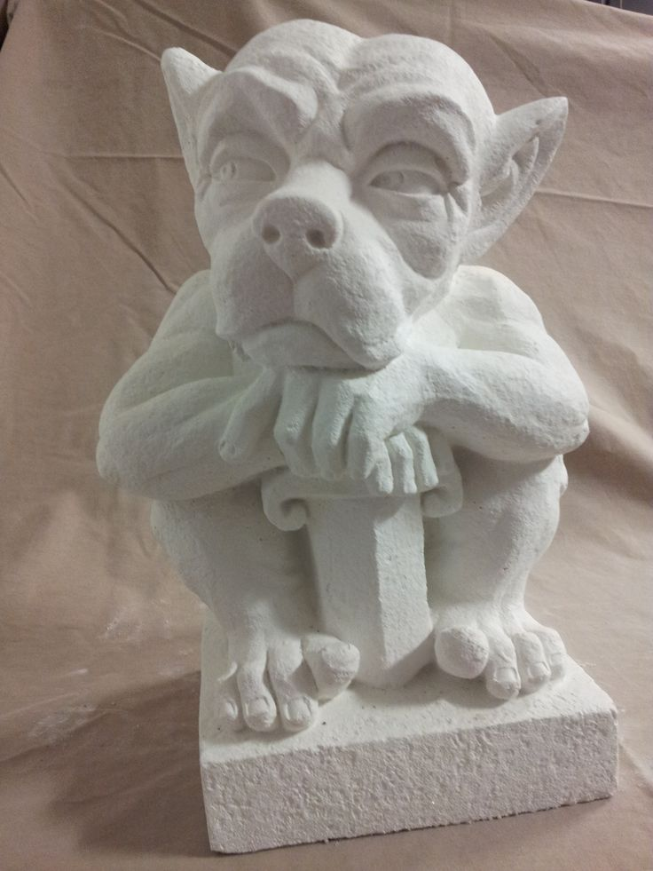 Gargoyle with sword molded using white concrete.