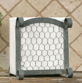 """Chicken Wire Napkin Caddy-Vintage metal appeal with a fab and functional farmhouse style wood handle grip. Done. Sold. So here it is! Features scrolls and chicken wire on both sides!Farmhouse Napkin Caddy measures6"""" wide, 5"""" deep and 6½"""" tall."""