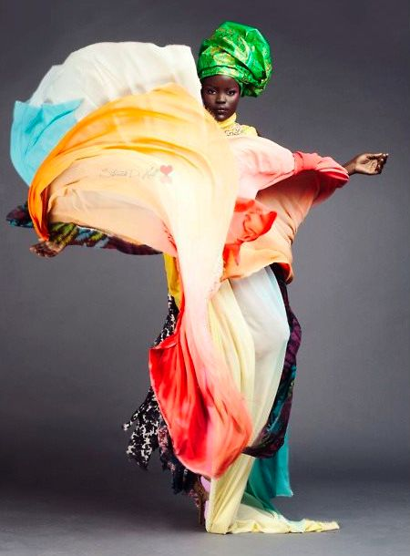 I love this photo -how the flurry of the fabric forms the shape of Africa.  Photographer unknown.