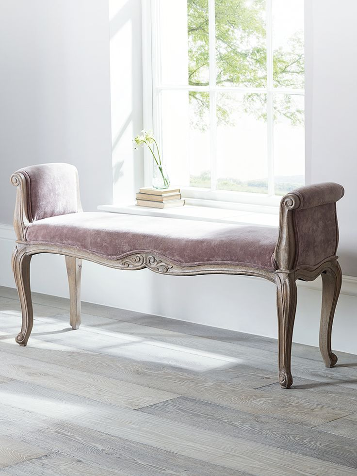 Upholstered in sumptuous 100% cotton velvet in a beautiful shade of soft blush mink, our elegant French-inspired furniture includes intricate hand carved mango wood details with a limewashed finish. Our long Loire Bench features a sumptuous padded seat and two tall arms with soft velvet details. Each bench has intricately carved arms and frame that has been finished by hand, adding romantic French style to your space. Use this bench under your window or at the end of your bed, and team with…