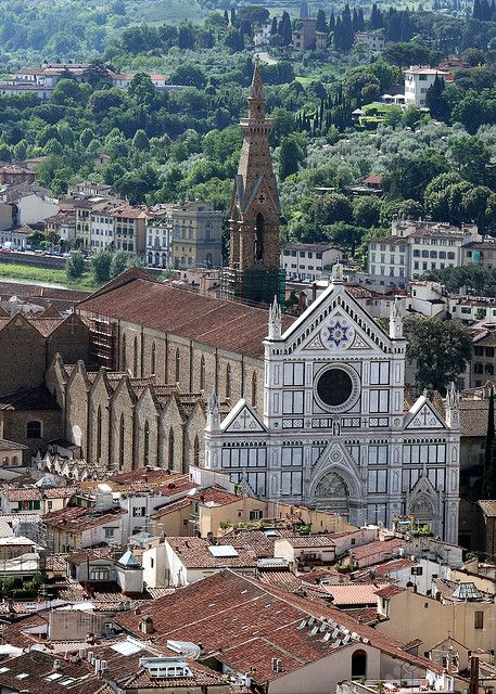 the medieval Church of Santa Croce, Florence, Tuscany has a 19th century neo-Gothic facade.  tombs of famous Florentines, including Michelangelo, Machiavelli, and Galileo, as well as a memorial to Dante.