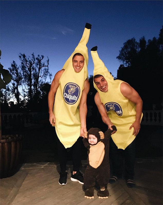 Robbie Rogers & Greg Berlanti from Stars Celebrate Halloween 2016  The soccer player and the showrunner monkeyed around with their banana-clad son Caleb.