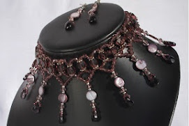 Hand crafted crystal heart formations around the neck and 9 crystal drops.
