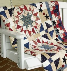 Americana Quilt.  What caught my eye was the blue star in the red star.  Upon further inspection I really love the little stars and circles at the edge and love the border to. http://blog.shopmartingale.com/quilting-sewing/patriotic-quilts/?utm_term=0_ab6bb44864-9ddf1423ad-302504749&utm_content=buffer52aa3&utm_medium=social&utm_source=pinterest.com&utm_campaign=buffer