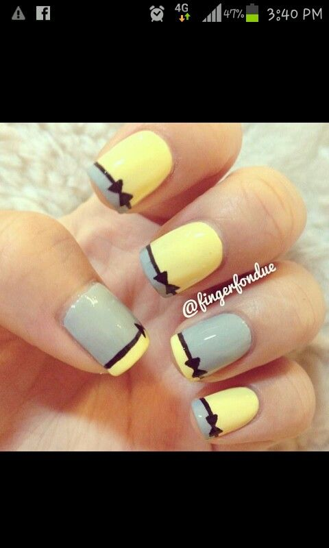 Yellow And grey bow tie nails