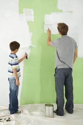 Covering a dark colored wall with a light color without first applying primer requires numerous coats of paint. Even covering one dark color with another dark color, such as painting deep red over ...