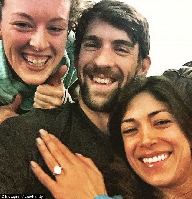 Pals: Swimmer Allison Schmitt also shared a picture of herself with the happy couple, which revealed Nicole's large diamond engagement ring.