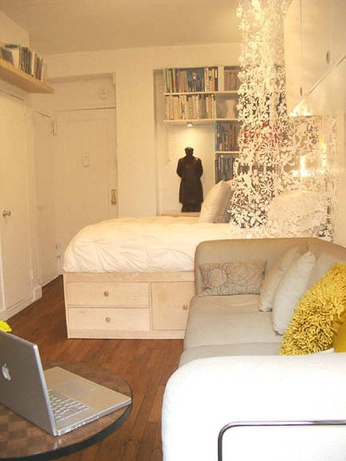 Studio Apartment...wouldnt mind my place looking like this when i live in los anglese next year. just instead of books id have shoes on the shelves.