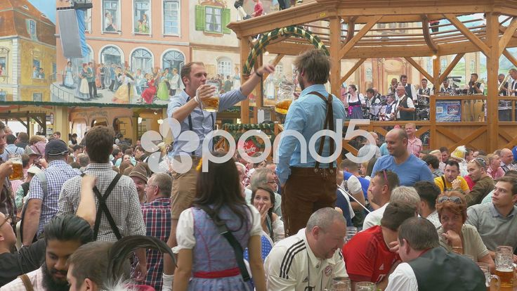 4K UHD Oktoberfest Munich Beer Festival Germany visitors drink a toast toasting …