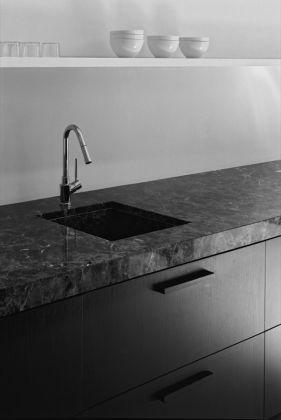 Black wood cabinets + dark grey natural stone countertop. Kitchen interior by Hans Verstuyft.