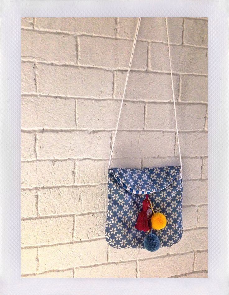 Petit canvas printing sling bag with tassel and pompom