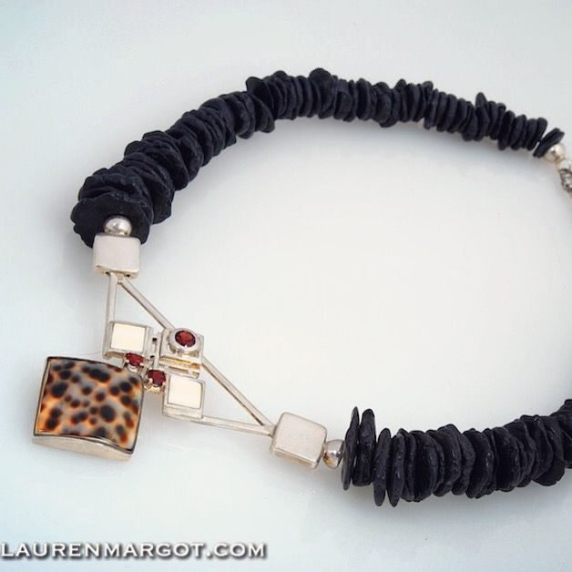 This piece from the African Range is very special, made from Sterling Silver Garnet Shell WarthogTooth & Howlite.