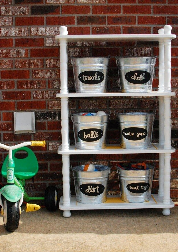 Set up an outdoor shelf stocked with labeled buckets to store the things you use in your yard. | 37 Insanely Clever Organization Tips To Make Your Family's Lives Easier
