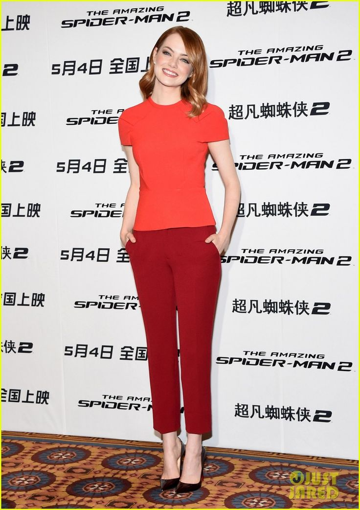 Emma Stone is sandwiched between her two hunky co-stars, boyfriend Andrew Garfield and Jamie Foxx, at the photo call and press conference for The Amazing Spider-Man…