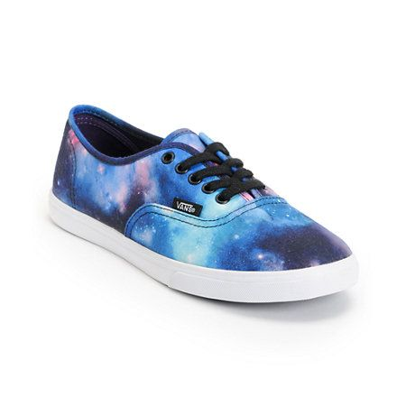 For style beyond this world, the Vans Authentic Lo Pro shoe in an all-overGalaxy Print  colorway. This classic girls low top shoe features an all canvas upper with black metal eyes and lace and an all-over blue and purple space print. Take your look to infinity and beyond with a comfortable padded midsole, micro-waffle outsole, and Vans classic style logos at the heel and sidewall.
