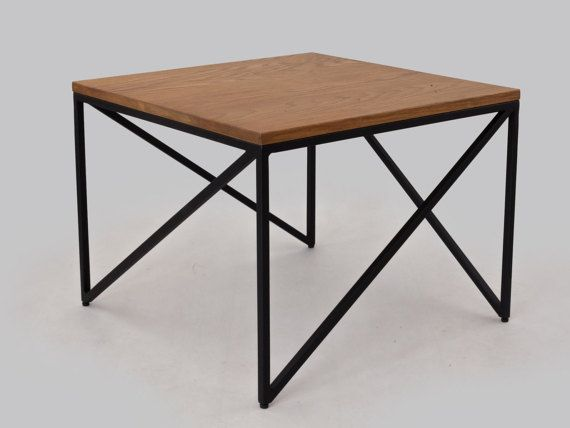 Table Trekant is characterized by geometric , universal form . The ideal combination is its steel base , which gives the interior a modern character with solid oak tabletop warming the room. We present two proposals color, but you can always compose your own version .   dimensions:  60cm x 60cm x 45cm  Top is 2 cm thick oak wood.