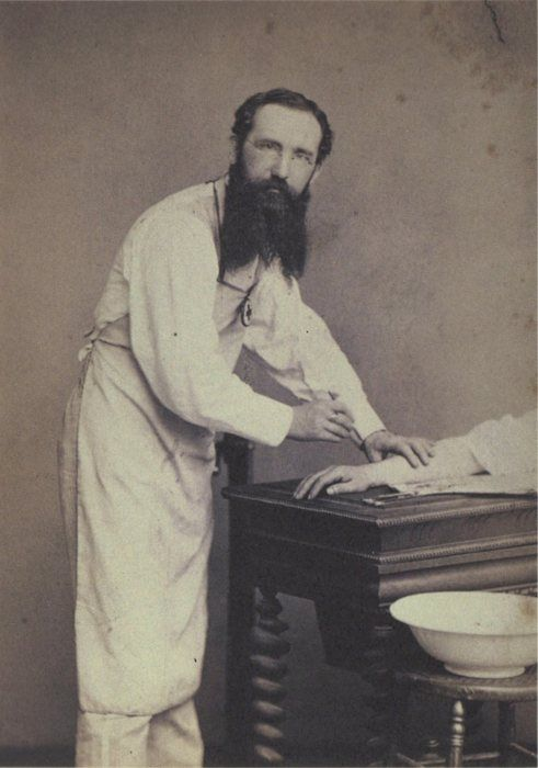 ca. 1888, [portrait of a surgeon operating on a hand], Louis Nagel via A Morning's Work: Medical Photographs from the Burns Archive, Stanley B. Burns