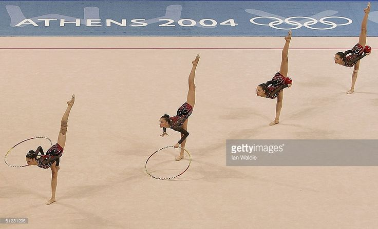 Team Bulgaria compete in the hoops and balls during the rhythmic gymnastics group finals on August 28, 2004 during the Athens 2004 Summer Olympic Games at the Galatsi Olympic Hall in Athens, Greece.