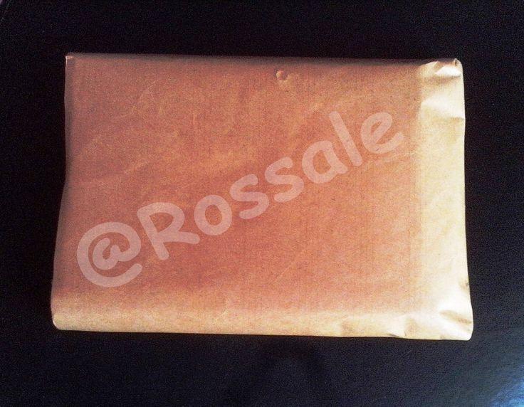 Packing dengan kertas cokelat sebagai lapisan kedua sebagaimana lazimnya sebuah paket dibungkus